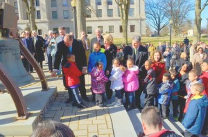 MMS students and children from Youth for Christ ring the bell of freedom with Governor and Joanne Tomblin and U.S. Senator Joe Manchin at the Capitol. Photo courtesy Charleston Gazette.