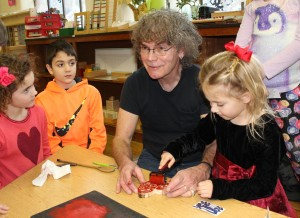 Well-known Appalachian artist Charly Hamilton leads a wood print class for lower elementary students.