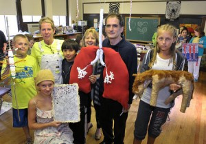MMS faculty members David Pushkin and Barrie Kaufman with students who created art inspired by the Hawks Nest Tunnel Disaster. Photo by Craig Cunningham, Charleston Daily Mail