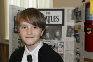 Ellis got into character for his presentation on the Beatles to families, faculty and the community.